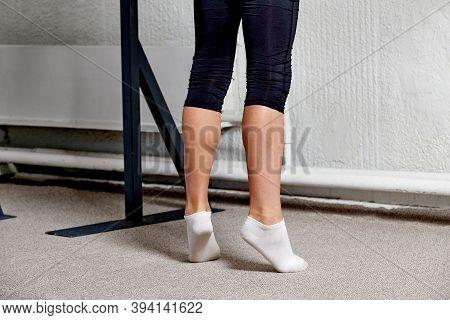 Men Feet In White Socks Training Before Sports. Ballet Classes. Coloured Carpet.