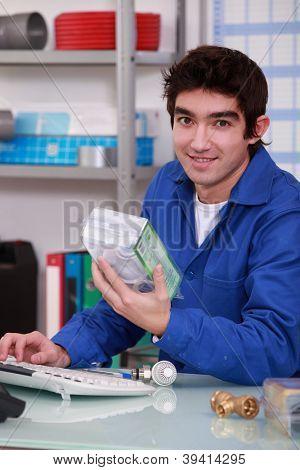 Worker in plumbing shop