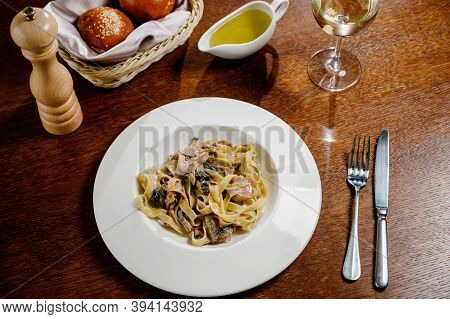 Creamy Mushroom Spinach Pasta.spaghetti Pasta With Mushrooms, Creamy Sauce And Parsley On Wooden Bac