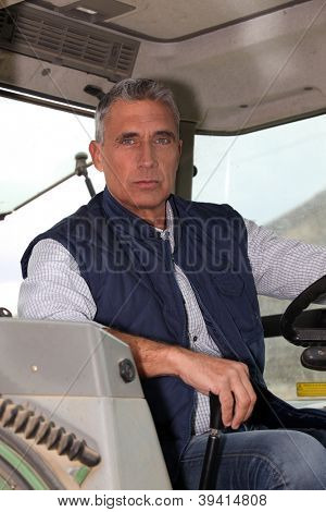Farmer in the cab of his tractor