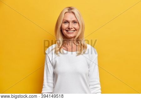 Optimistic Glad Blonde Middle Aged Woman Smiles Toothily Happy To Spend Free Time In Family Circle W