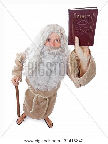 monk holding a Bible