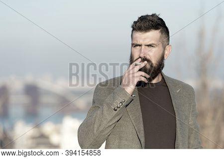 Nicotine Abuse. Cigarette Smoker. Bearded Man Smoke Nicotine Cigarette Outdoor. Addiction To Nicotin