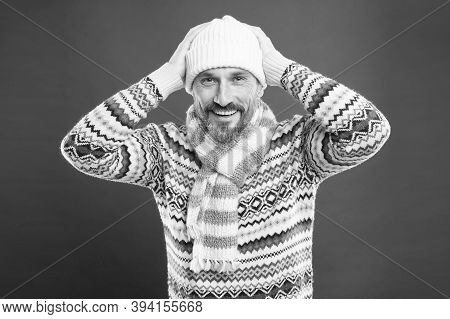 Dont Let Cold Winter Weather Affect Your Style. Happy Man In Winter Style Red Background. Mature Man