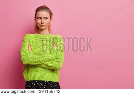 Displeased Young European Woman Being Angry With Boyfriend, Keeps Arms Folded, Smirks Face, Stands I