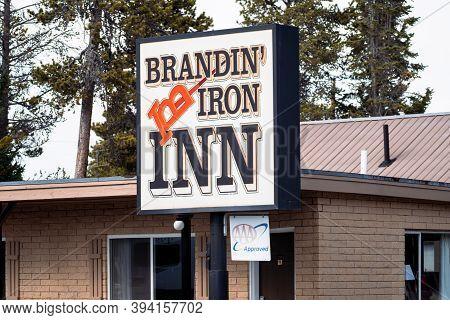 West Yellowstone, Montana - September 24, 2020: Sign For The Brandin Iron Inn Motel In The Gateway T