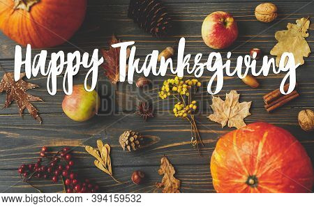 Happy Thanksgiving Text Sign On Pumpkins, Autumn Leaves, Apples, Anise, Cones, Acorns And Berries On