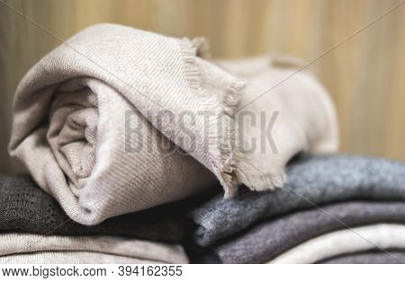 Pile Of Clothes, Rolled Beige Cashmere Blanket, Knitting Cashmere Wool Yarn, Closeup Beige Blanket,