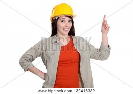 Female construction worker holding up her finger