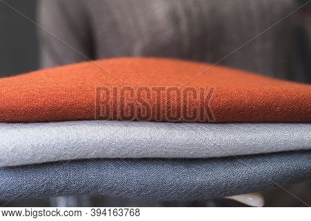 Orange Grey White Wool Sweater, Close Up Of Colorful Fabric,  A Pile Of Cashmere Textile, Stack Of C