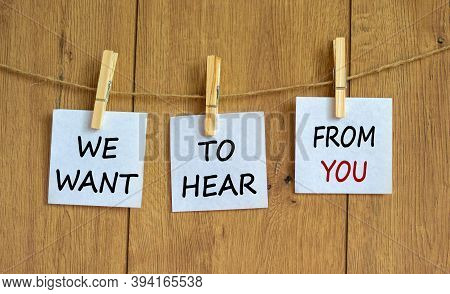 Wooden Clothespins With White Sheets Of Paper. Text 'we Want To Hear From You'. Beautiful Wooden Bac