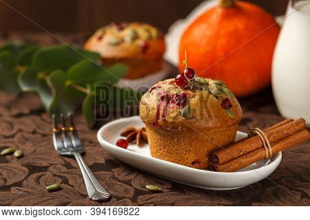 Pumpkin Muffin Close-up With Cranberries And Seeds. Traditional Autumn Dessert On The Table With A J