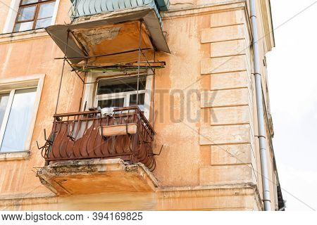 Old Balcony Of Old House And Birch Grow On The Balcony