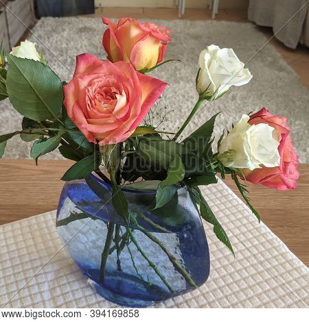 Beauty In Nature Image. Pretty Pink And White Roses In A Translucent Blue Valse On A White Coffe Tab