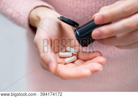 Closeup Shot Of An Unrecognizable Woman Holding A Medication In His Hands. Healthcare And Medical Co