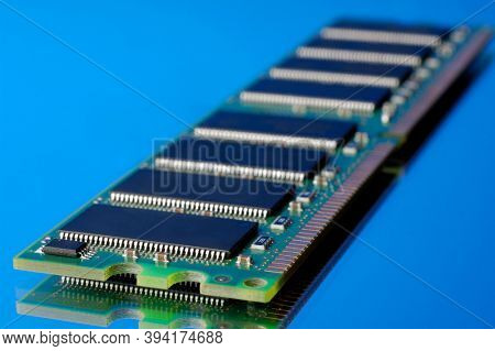 SDRAM DDR computer memory stick on blue background