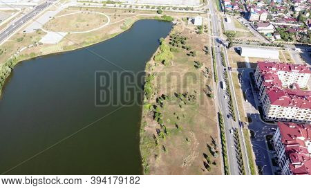 Aerial Of Summer Landscape With A Town, Residential Houses And A Beautiful Lake. Clip. View From The