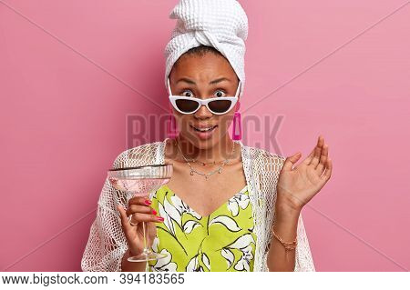Horizontal Shot Of Surprised Lady Dressed In Summer Dress With Shawl, Towel On Head, Imagines Having