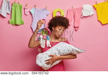 Busy Responsible Mother Soothes Crying Baby, Shows Crib Mobile, Nursing Newborn Alone, Comforts Smal