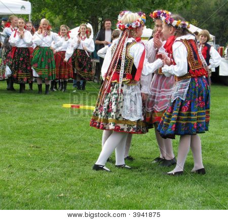 Young Girls In Colorful Polish Costumes