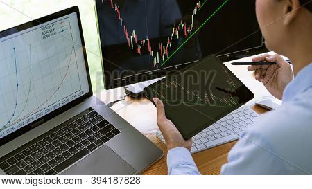 Stock Exchange Trader Working  With Graphs,diagrams On Monitor In Modern Trading Office.