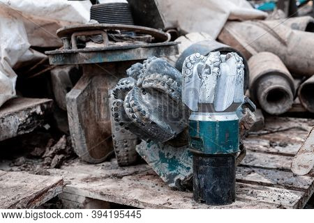 The Drill Bit, Shot Close-up With Shallow Depth Of Field. Industrial Background. Tricone Drilling Bi