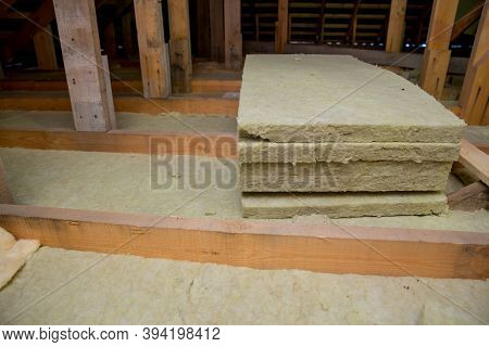 Insulation Of The Ceiling With Fiberglass. Roof Insulation. Laying And Insulation With Stone Wool An