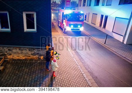 Romrod, Hessen, Germany - November 10, 2020: Families And Children Interact With Firefighters. Firem