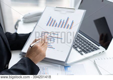 Financial businesswomen use laptop and smart phone to analyze marketing strategies and real estate d