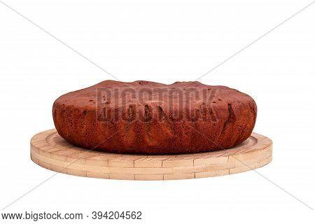 Homemade Chocolate Sponge Cake On Wooden Plate.