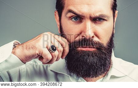 Beard Is His Style. Male With Mustache Growing. Portrait Of Bearded Male In White Shirt. Close Up Of
