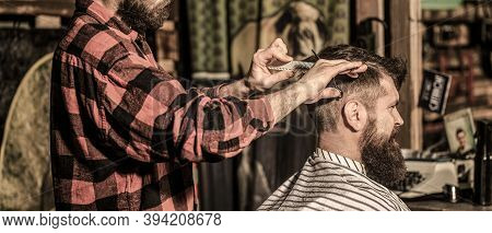 Work In The Barber Shop. Man Hairstylist. Hairdresser Cutting Hair Of Male Client. Man Visiting Hair