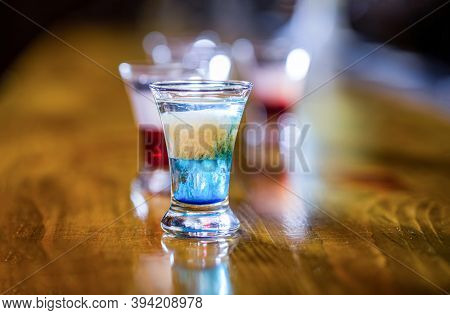 Alcoholic Drinks In Shot Glasses. Tequila Shots, Vodka, Whisky. Set Of Alcoholic Cocktails In Shot G