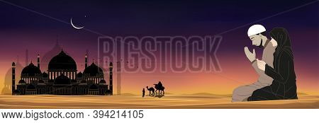 Mosque Silhouette With Muslim Man And Woman Making A Supplication (salah)sitting On Desert Sand,arab