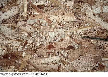 Chipboard. A sheet of Chipboard plywood with wood grain. Chipboard is used world wide in many construction projects. Made from scraps of wood it is compressed and glued into sheets for construction.
