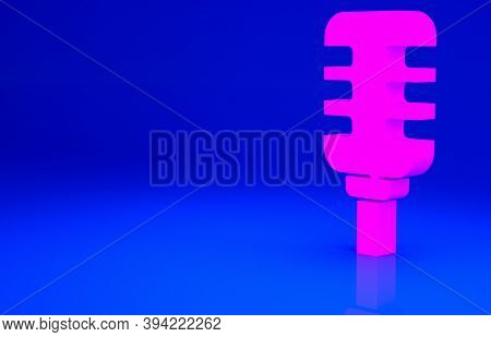 Pink Microphone Icon Isolated On Blue Background. On Air Radio Mic Microphone. Speaker Sign. Minimal