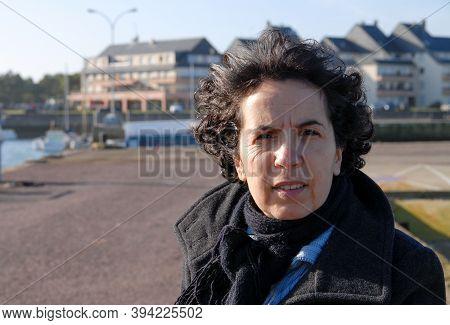 A Portrait Of Pretty Mature Brunette Woman Outdoor