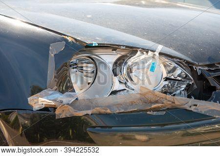 A Broken Car Headlight, Aa Grey Car