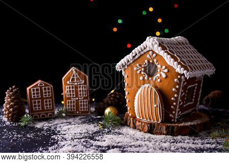 Winter Gingerbread House With Light From The Windows, Gingerbread City, Big Side Lights, Snow. New Y
