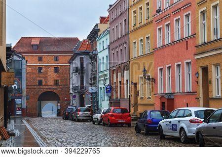 Torun, Poland - December 01, 2016: View Of The Ducha Swietego Street And The Monastery Gate (brama K