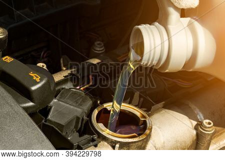 Engine Oil. Pouring Motor Oil Into The Engine