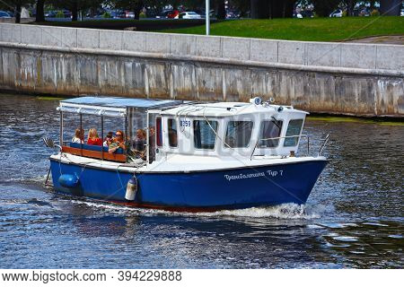Kaliningrad, Russia - August 22, 2019: Cruise Boat On The Pregolya River With Passengers On A Sights