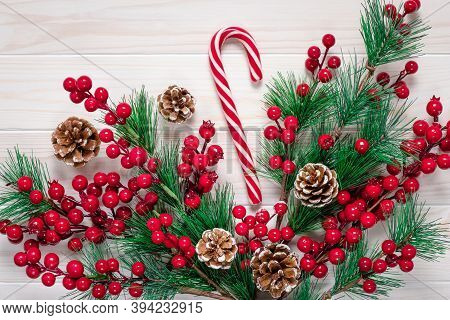 Christmas Season. Christmastime, Gift Card With A Candy Cane With Red Stripes. Winter Design With De