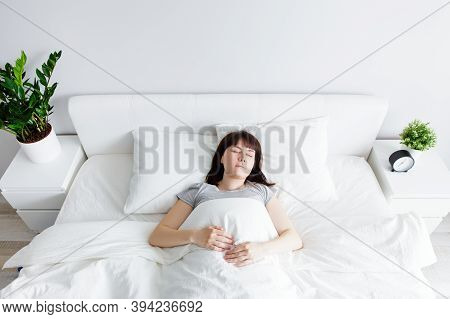 Good Morning Concept - Top View Of Happy Woman Sleeping At Home Or Hotel