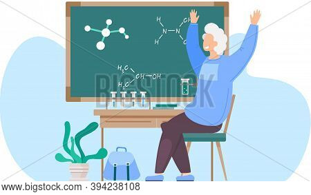 Cheerful Schoolboy Sits In A Chemistry Classroom. The Smiling Guy On The Chair Rejoices And Raises H