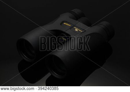 Prague,czech Republic - 9 November,2020: Black Nikon Prostaff Binocular Isolated On Black Background