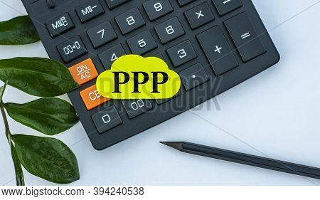 Ppp - Word On A Yellow Note Sheet On A White Background With A Calculator, Pencil And Green Sheet. B