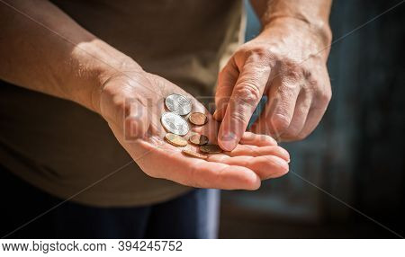 Concept Of Poverty, And Destitution, Money And Coins. Poor People, Need A Help