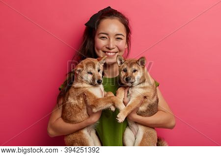 Happy Brunette Girl Adopts Two Puppies From Shelter, Happy To Have New Friends, Holds Pets, Being Do
