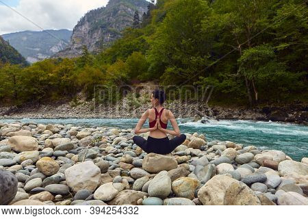 Yoga Classes In Nature. The Concept Of Playing Sports Alone. Social Exclusion. A Woman Does Yoga On